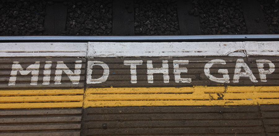 Mind the gap written on concrete